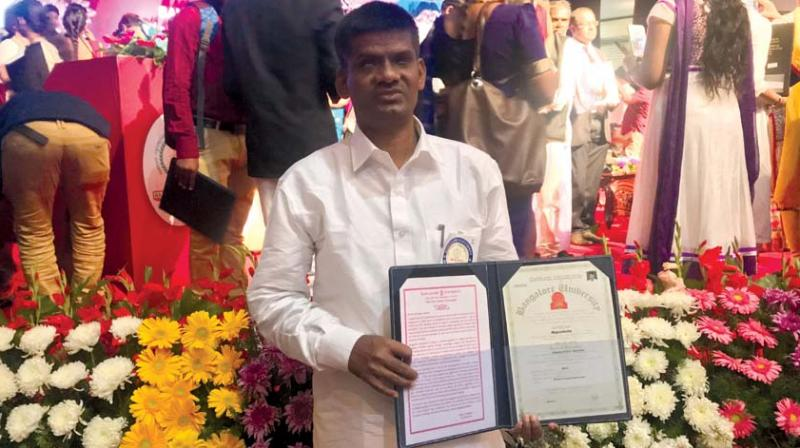 Nagashetty, who is visually impaired, with his PhD degree certificate. (Photo: DC)