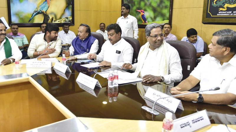 Chief Minister Siddaramaiah, water resources minister M.B. Patil and BJP leaders Jagadish Shettar and K.S. Eshwarappa at a meeting on the Mahadayi tribunal in Bengaluru on Thursday