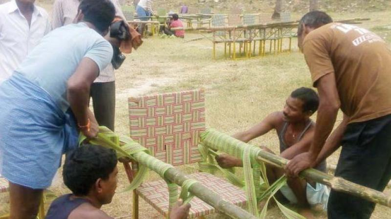 Doliwallahs from Jharkhand prepare a 'doli' to carry devotees to Vindhyagiri