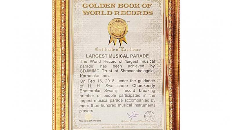 """A musical parade held around the Vindhyagiri Hill on the eve of the Mahamastakbahisheka of the towering statue of Bahubali atop it, has won the """"Golden Book of World Records""""."""