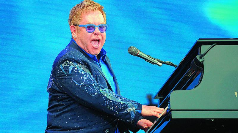 Elton John screams at fan during gig