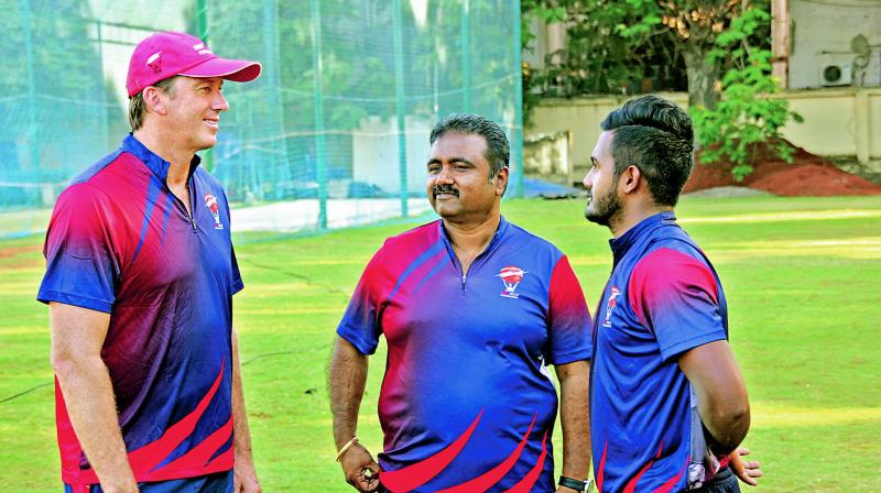 Glenn McGrath (left) interacts with MRF Pace Foundation trainee K.M Asif (right).