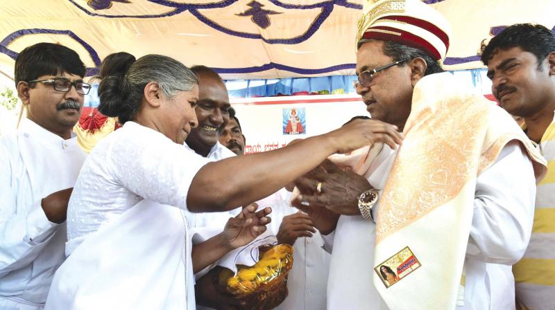 Chief Minister Siddaramaiah being felicitated at Nanjangud on Monday.  (Photo:KPN)