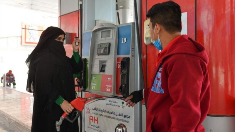 Mervat Bukhari becomes the first Saudi woman to work at a gas station, something unimaginable not long ago. (Photo: AFP)