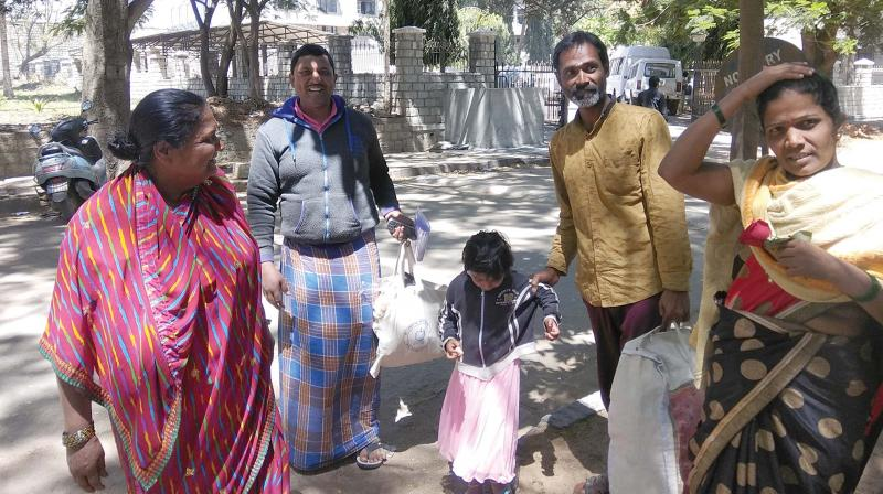 Veeranna (2nd R) walks out of Parappana Agrahara along with his younger brother Ajay and other family members on Wednesday