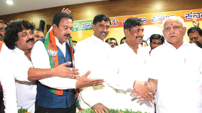 BJP state president B.S. Yeddyurappa welcomes retired police officer BNS Reddy and others to the party on Wednesday