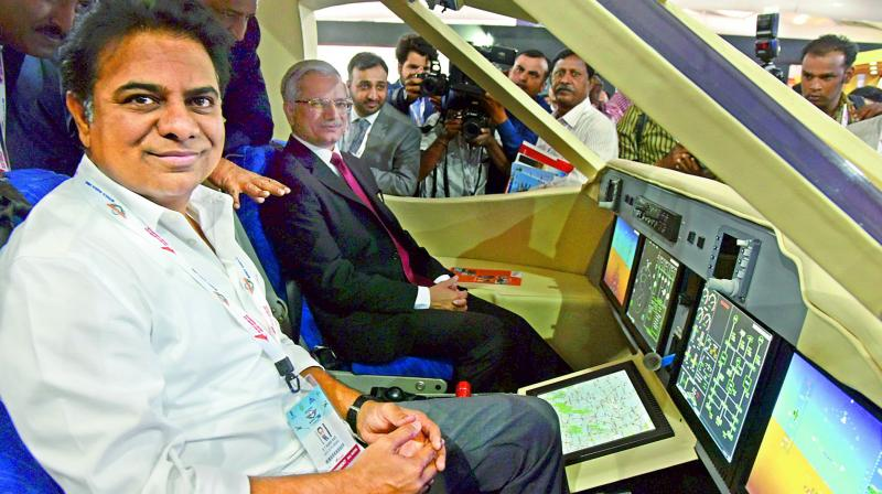 Telangana industries minister K.T. Rama Rao sitting in a model cockpit at Wings India on Thursday. (Photo:DC)
