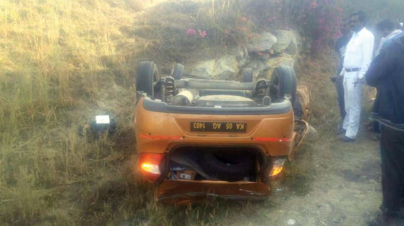The car that overturned, killing three students on board on NICE Road in Bengaluru on Friday. (Photo:DC)