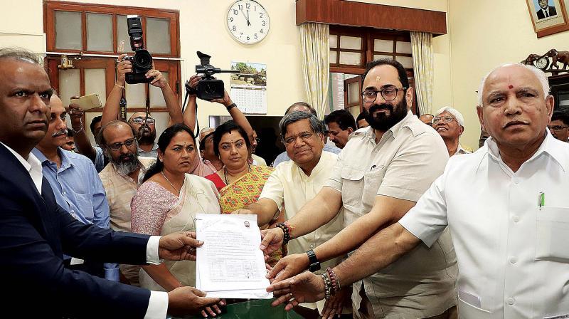 BJP candidate for the Rajya Sabha poll, Rajeev Chandrasekhar (centre), filing his nomination in the presence of BS Yeddyurappa, Jagadish Shettar and others at Vidhana Soudha, in Bengaluru on Monday. (Photo:DC)