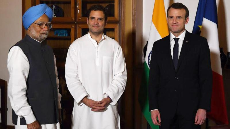 French president Emmanuel Macron met Congress chief Rahul Gandhi and former prime minister Manmohan Singh on Sunday. (Photo: Twitter/@OfficeOfRG)