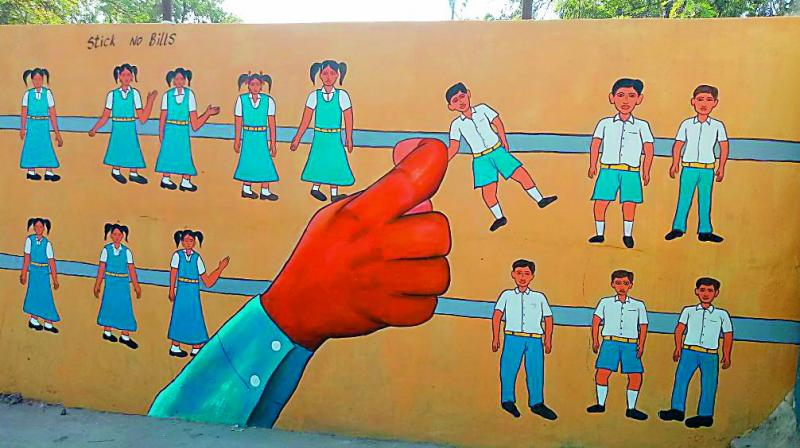 Government school wall painted with a series of boy and girl figures arranged to look like an abacus containing the beads in a straight line