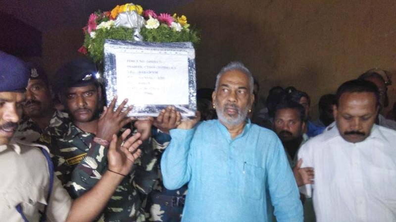 Hassan district in charge and Minister for Animal Husbandry A Manju carries mortal remains of soldier Chandra in Hassan on Wednesday