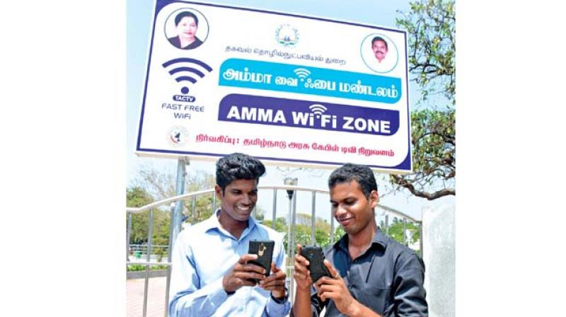 Visitors trying out newly launched Amma Wifi zone facility at Labour statue at Marina beach on Friday. Tamil Nadu Cable TV Corporation has installed the facility at Chennai, Madurai, Tiruchy, Salem and Coimbatore.  (Photo:DC)