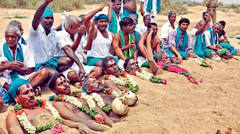 Farmers bury themselves neck-deep in the sands of Cauvery river at Odathurai bathing ghat on Friday  demanding immediate constitution of Cauvery Management Board (CMB).  (Photo:DC)