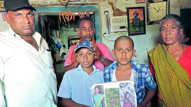 Teku Laxmi's husband, Gopi (wearing a black cap and white shirt) with his two sons and mother at his residence in Gosampalle Yellapur in Khanapur mandal in Nirmal district on Sunday.