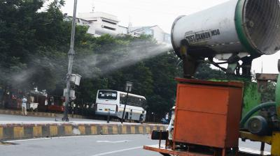 With things getting frantic in several states, civic agencies have doubled up on disinfecting as many streets as possible. This is a scene from Visakhapatnam, where the Greater Vizag Municipal Corporation is using mist cannon to spray sodium hypochlorite on roads and buildings.  (DC Photo: Murali Krishna)