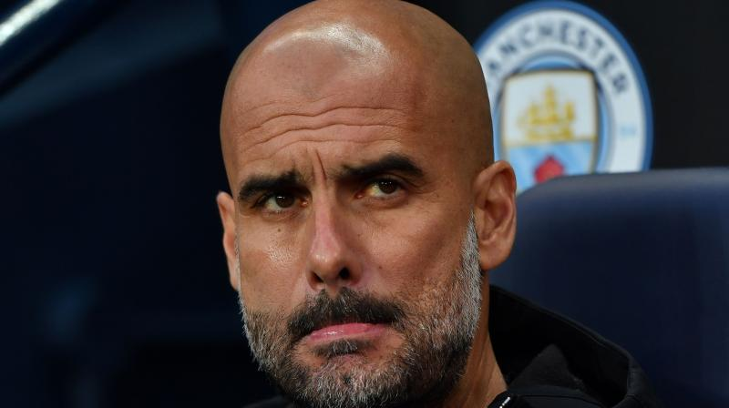 "UEFA says Guardiola has been charged with ""improper conduct"" and ""dismissal from the bench"" during Man City's 2-1 loss on Tuesday. Liverpool advanced 5-1 on aggregate. (Photo: AFP)"