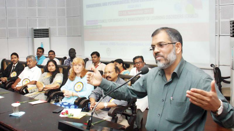 Calicut University vice-chancellor Dr K. Muhammed Basheer addresses the seminar on learning disability on the varsity campus on Friday.(Photo: DC)