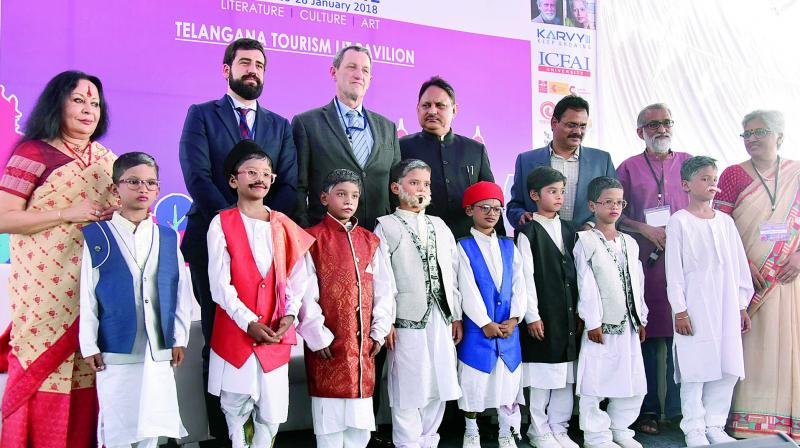 Children dressed as eight Gnyanpith awardees of Karnataka pose with deputy head mission of Spanish embassy, Eduardo Sanchez Moreno (third from left), cultural attache, Ignacio Vitorica Hamilton (second from left), chief secretary S.P Singh (centre) and artist Sonal Mansingh (left) at the Hyderabad Literature Festivalon Friday.	—DC