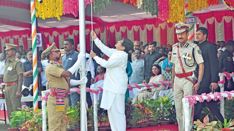 Lt Governor Kiran Bedi  unfurls the national flag at the Republic Day  celebrations, Puducherry, on Friday. (Photo: DC)