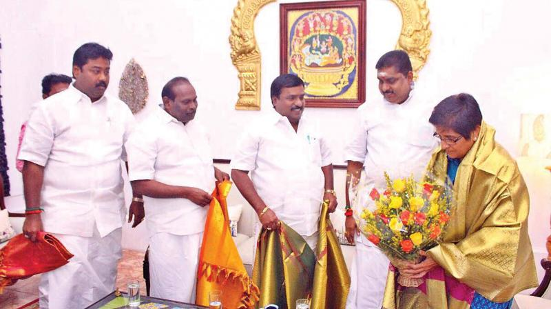 Ministers and legislators call on Lt Governor Kiran Bedi at Raj Nivas in Puducherry on Saturday. (Photo: DC)
