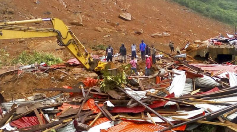 Mudslides and torrential flooding has killed many people in and around Sierra Leone's capital early Monday following heavy rains, with many victims thought to be trapped in homes buried under tons of mud. (Photo: AP)