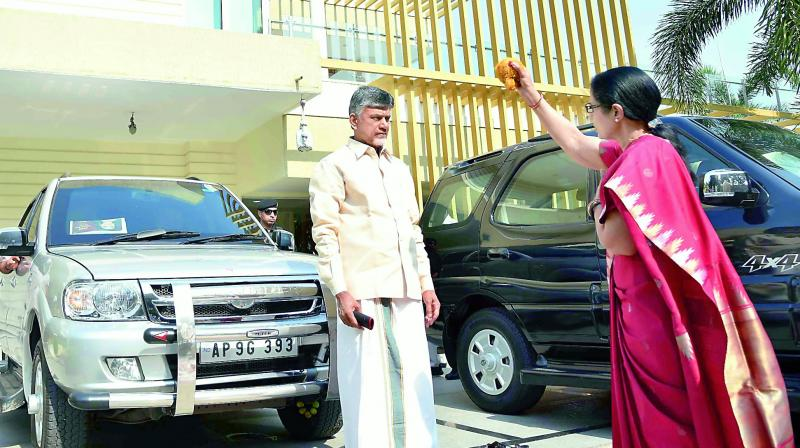 Chief Minister N. Chandrababu Naidu's wife N. Bhuvaneswari performs 'drishti' at their Undavalli residence in Guntur district on Saturday, before leaving for Tirupati to begin the election campaign.