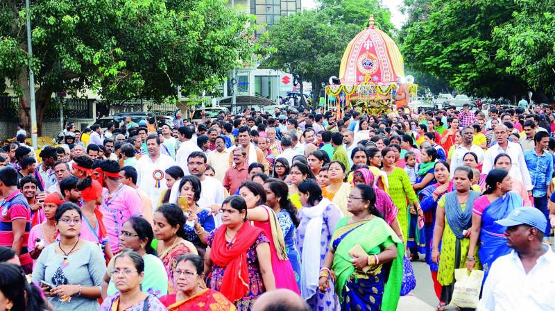 A large number of devotees pull the rope of a chariot carrying an idol of Lord Jagannath during the Rath Yatra celebrations organised by Utkal Samskritka Samaj near Siripuram in Visakhapatnam on Thursday. (Photo: Deccan chronicle)