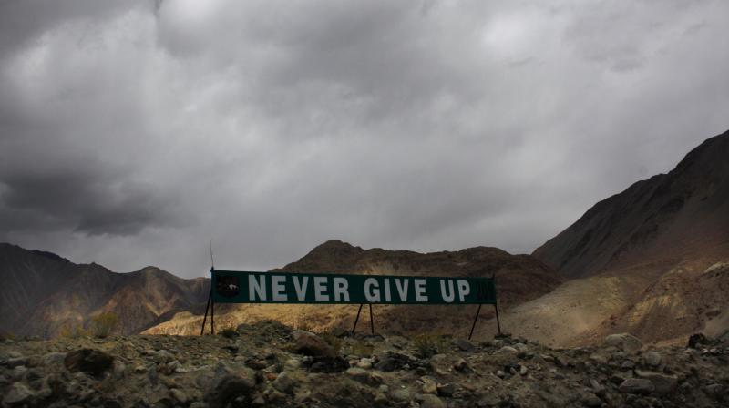 In this Sept. 14, 2017, file photo, a banner erected by the Indian army stands near Pangong Tso lake near the India-China border in Ladakh area. The focus now is on disengaging troops from Hot Springs, Gogra and Depsang areas. (AP/Manish Swarup, File)