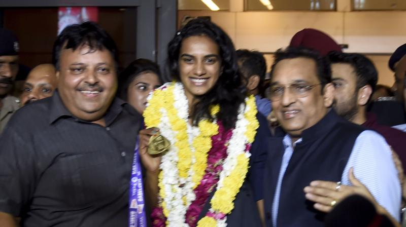 'Wish to win more medals for India': PV Sindhu after arrival in India