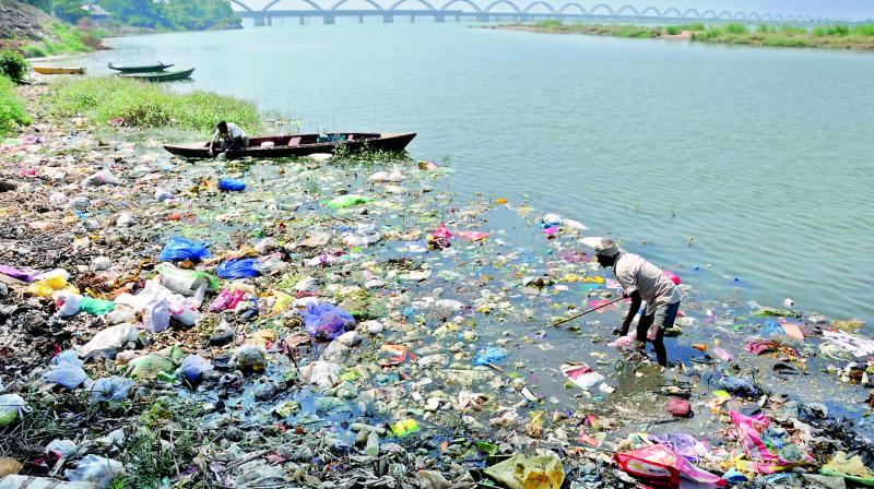 A file picture of garbage and plastic piled up on the banks of river Godavari in Rajahmundry.