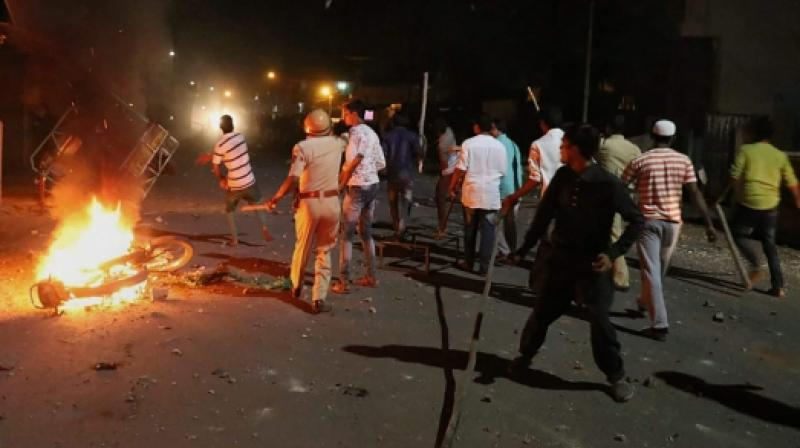 Rioters hurl stones and sticks during a communal riot that escalated due to clamping illegal water connection in a religious place in Moti Karanja area of Aurangabad. (photo: PTI)