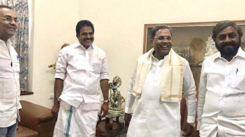 From right: Former Chief Minister Siddaramaiah, Congress General Secretary K.C. Venugopal and KPCC president Dinesh Gundurao in Bengaluru on Sunday (Photo: DC)