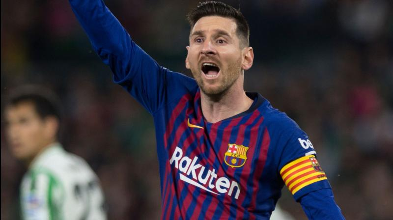 The Argentine put Barca further at ease with another strike at the end of the first half, finishing off a backheeled pass from Luis Suarez as the two South American forwards carved their way through Betis's defence. (Photo: AFP)