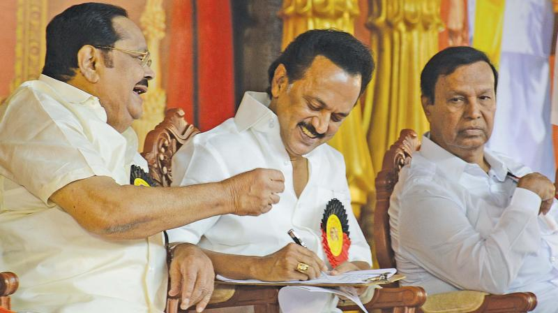 DMK president MK Stalin and treasurer Durai Murugan share a light moment at the party's general council meeting in Royapettah on Sunday. Principal secretary TR Baalu is also seen.(Photo: DC)