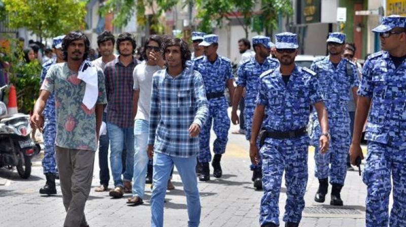 In this file photo, Maldives police patrol the streets of the capital Male. (Photo: AFP)