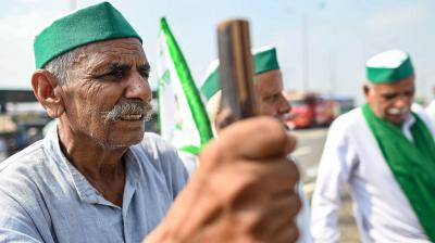 Farmers gather at the protest venue in Gazipur Delhi-Uttar Pradesh border during a nationwide strike called by the farmers as they continue to protest against the central government's agricultural reforms in Ghaziabad on September 27, 2021. (AFP)