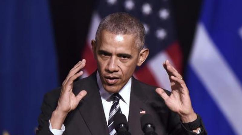 US President Barack Obama gestures as he speaks at the Niarchos foundation in Athens on Wednesday. (Photo: AFP)