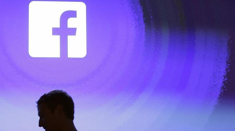 """Facebook also said it removed dozens of accounts for engaging in a campaign that """"used seemingly independent news and opinion pages to covertly push the messages of the Myanmar military.""""(AP Photo/Marcio Jose Sanchez, File)"""