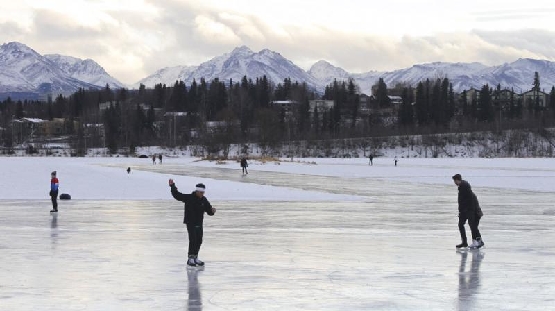 Ice skaters take advantage of unseasonable warm temperatures to ice skate outside at Westchester Lagoon in Anchorage, Alaska. (Photo: AP)