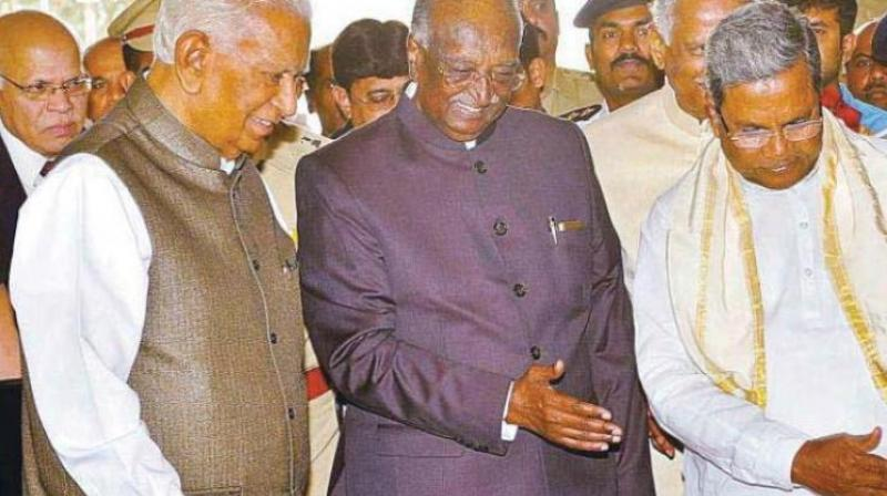A file photo of Legislative Council Chairman D.H. Shankaramurthy and CM Siddaramaiah receiving Governor Vajubhai Vala in Vidhana Soudha