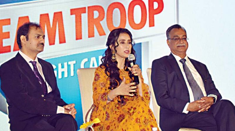Actress and cancer survivor Manisha Koirala with Dr. H Sudarshan Ballal, Chairman Manipal Hospitals and  Dr Somashekar, Chairman and HOD Surgical Oncology, Manipal Hospitals during a 'Cancer less Future' program at Manipal Hospital, in Bengaluru on Monday (Image DC)