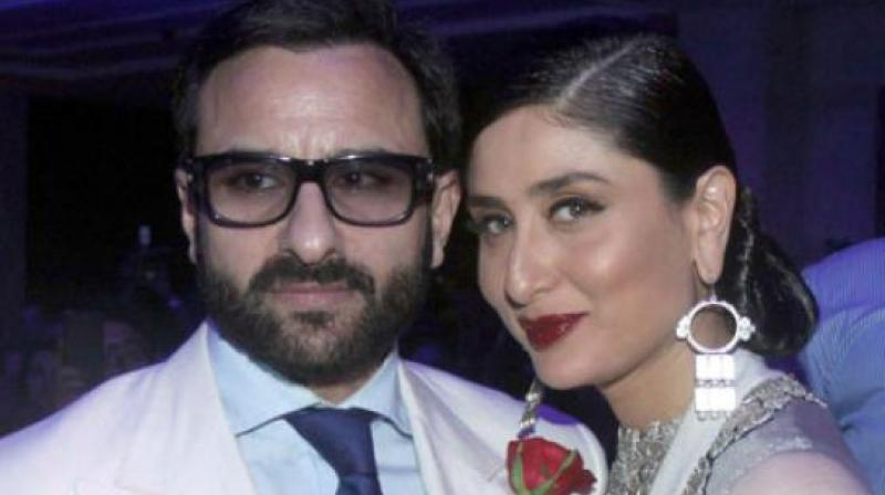 Saif Ali Khan and Kareena Kapoor Khan at Lakme Fashion Week 2015.