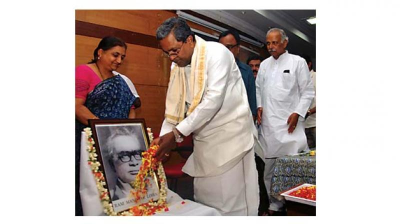 Former chief minister Siddaramaiah offers floral tribute to the portrait of Dr Lohia to mark his birth anniversary in Bengaluru on Saturday.     (Photo:  KPN