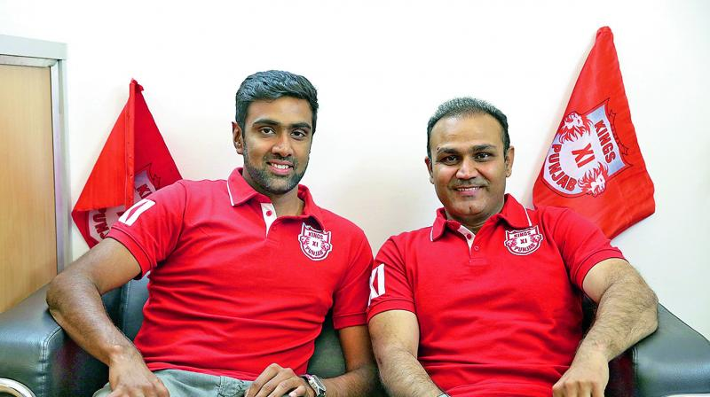 Newly-appointed Kings XI skipper R. Ashwin and Virender Sehwag, mentor of the team.