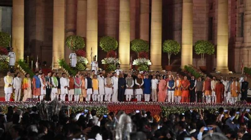 In a sartorial sense too, kurta-pyjama was the dominating theme as most of the MPs turned up in kurta-pyjama, colourful waistcoat or their traditional dresses, while a few chose to wear shirts and trousers. (Photo: AFP)