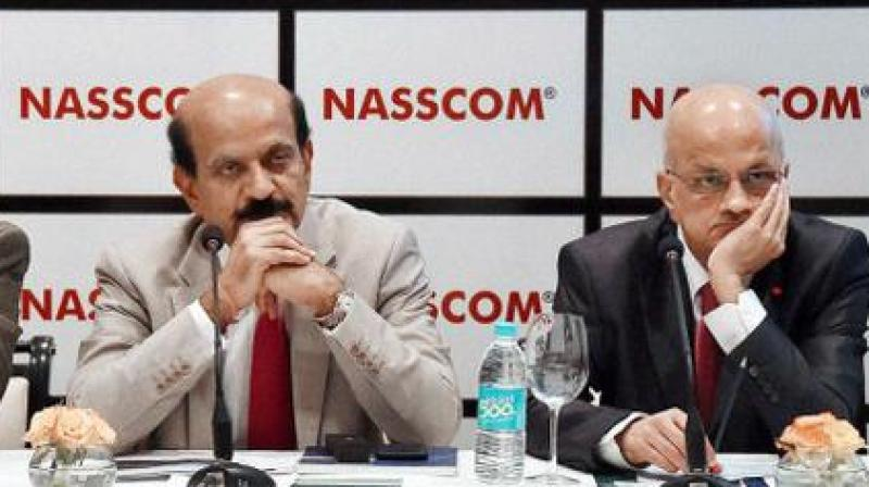India's low position in ease of doing business ranking is worrying, Nasscom President R Chandrashekhar (right) said.