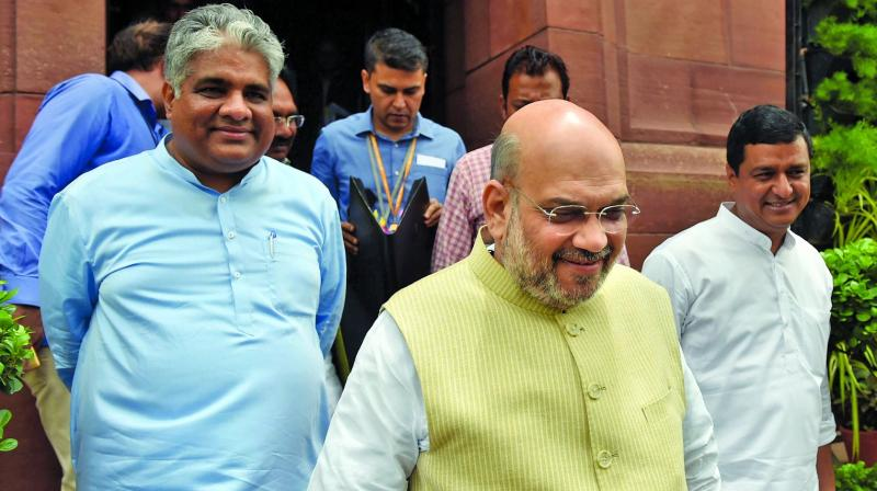 Union home minister Amit Shah with BJP MP Bhupendra Yadav during the Budget Session at Parliament in New Delhi on Wednesday.  (PTI)