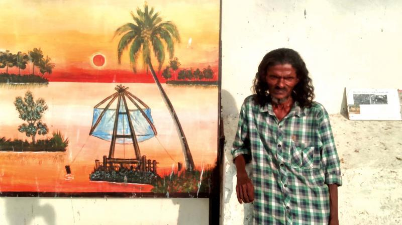 Artist Jaleel with his painting.