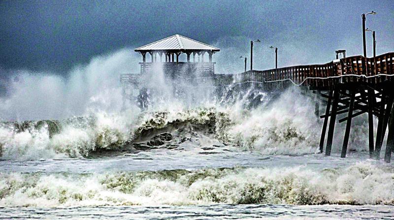 Waves slam the Oceana Pier & Pier House Restaurant in Atlantic Beach, North Caroline on Thursday as Hurricane Florence approaches the area.  (Photo:AP)